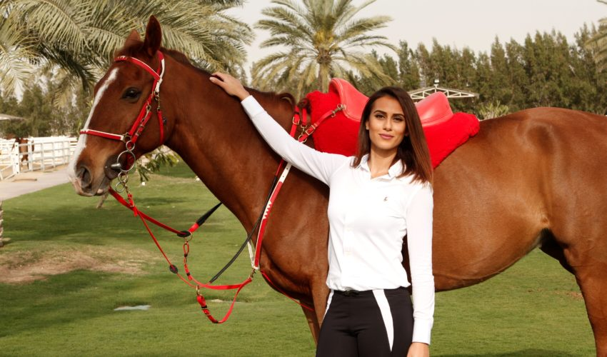Endurance World Manal Fakhrawi. Posing with a horse.